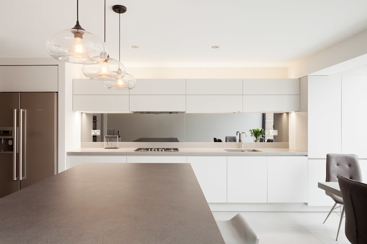 Rear & side wrap-around extension:  Built-in kitchens by Proctor & Co. Architecture Ltd