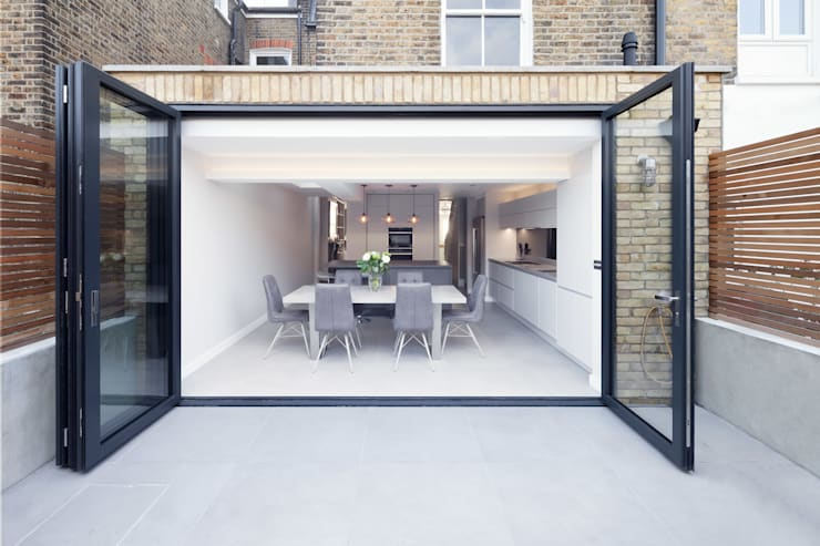 Rear & side wrap-around extension:  Dining room by Proctor & Co. Architecture Ltd