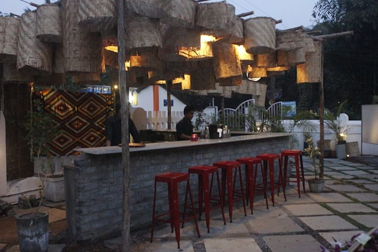 June Garden Bistro:  Bars & clubs by Finch Architects