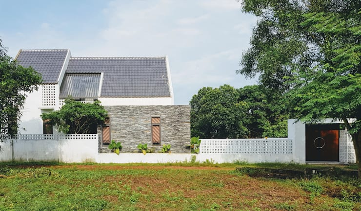 NEW HOUSE:  Nhà gia đình by RÂU ARCH