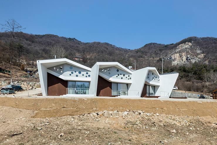 Maisons de style  par HGA 건축디자인연구소, Moderne Béton armé