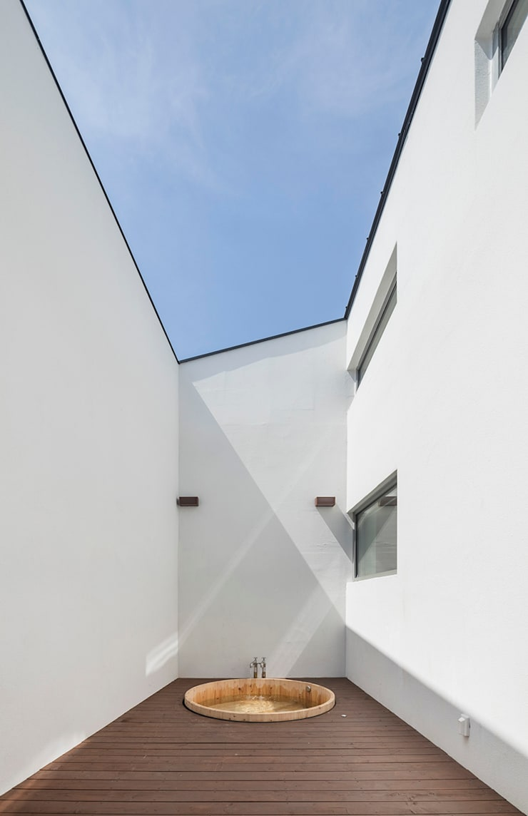 Spa de style  par HGA 건축디자인연구소, Moderne Béton armé