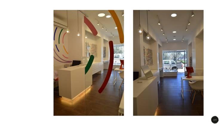 equipamiento: Galerías y espacios comerciales de estilo  por OH! estudio diseño & arquitectura