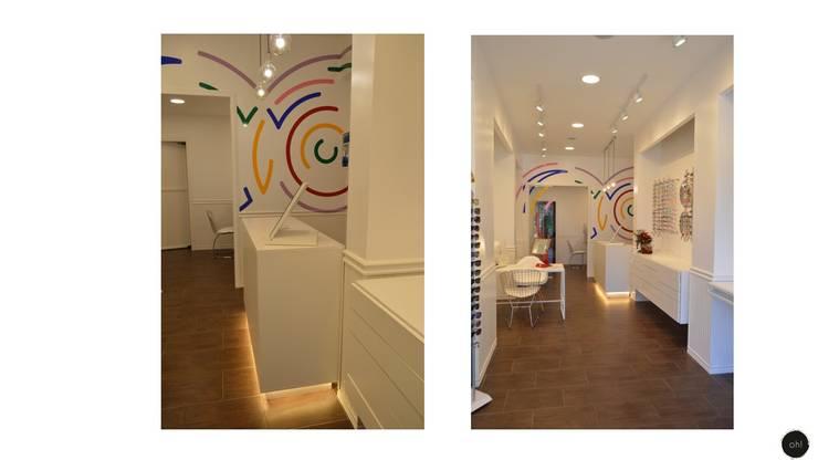 interior -: Galerías y espacios comerciales de estilo  por OH! estudio diseño & arquitectura
