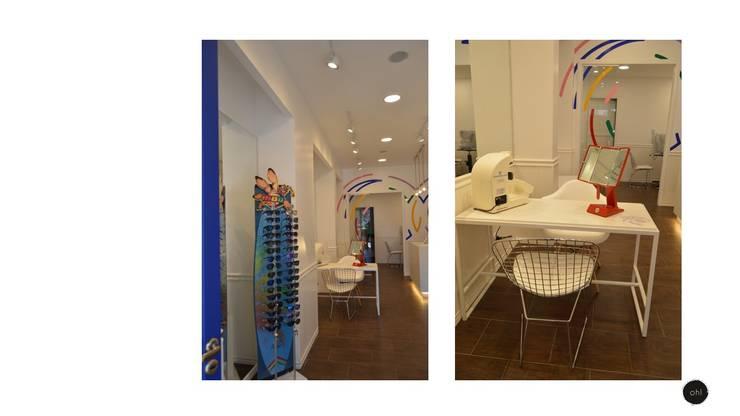 muebles contemporáneos en espacio mèdico: Galerías y espacios comerciales de estilo  por OH! estudio diseño & arquitectura