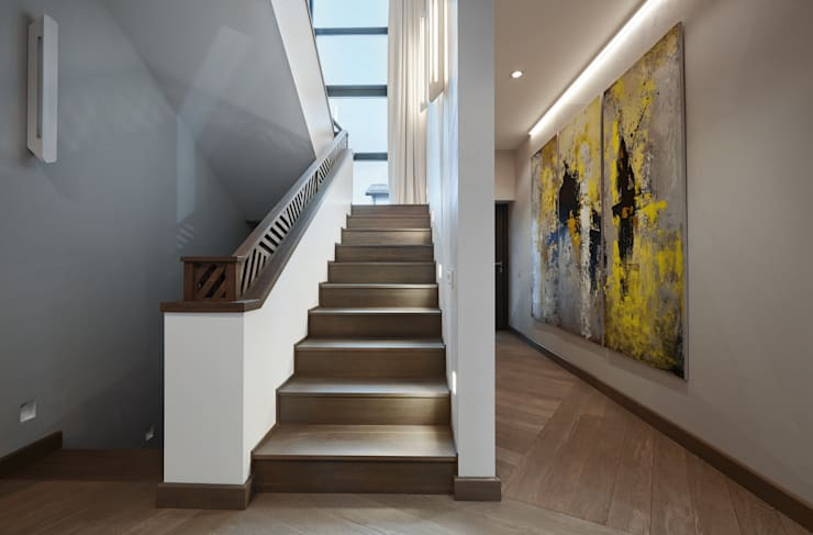 Pasillos y hall de entrada de estilo  por Unique Design Company