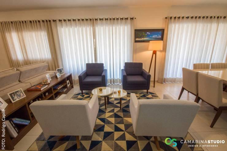 Living room by Camarina Studio