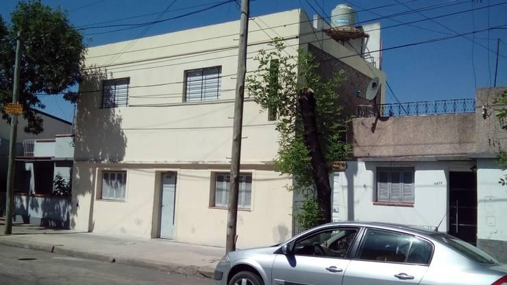 Casa Familiar. Calle Corrientes. Rosario.: Casas de estilo  por Arq. Gustavo Piazza & Asociados