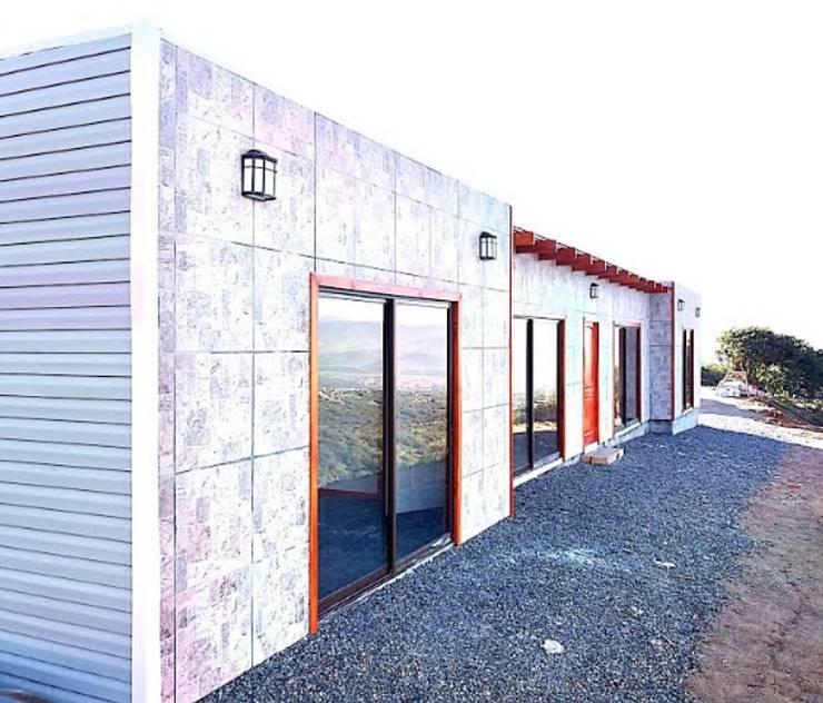 Casas prefabricadas de estilo  por Constructora Milan