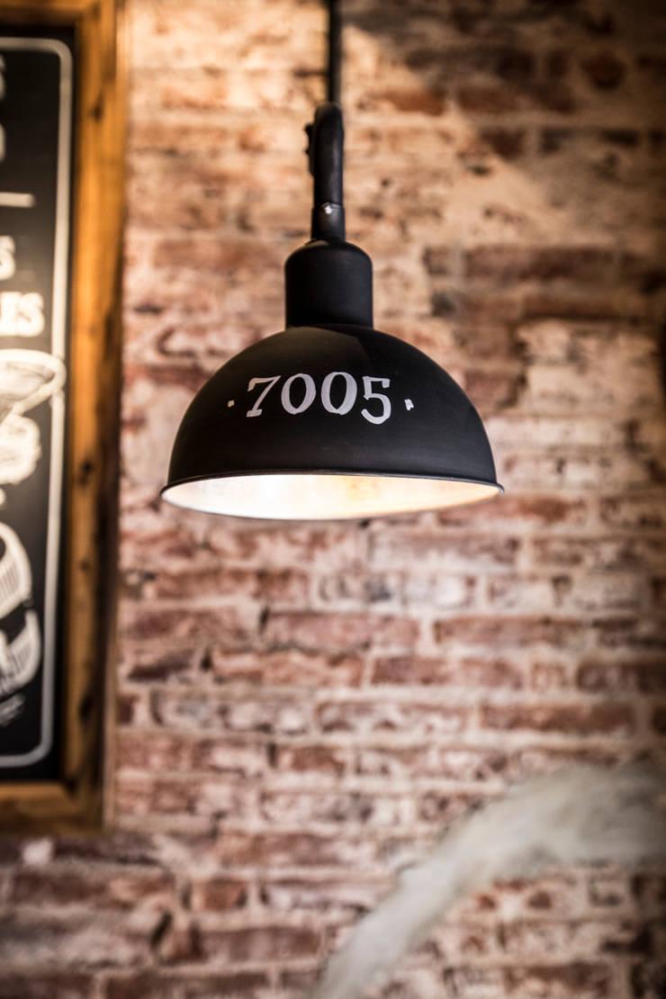 CAMPESTRE   Restaurante Argentino: Oficinas y locales comerciales de estilo  por María Florencia Funes