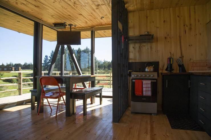 Area de Living, Comedor y Cocina: Livings de estilo  por Nido Arquitectos