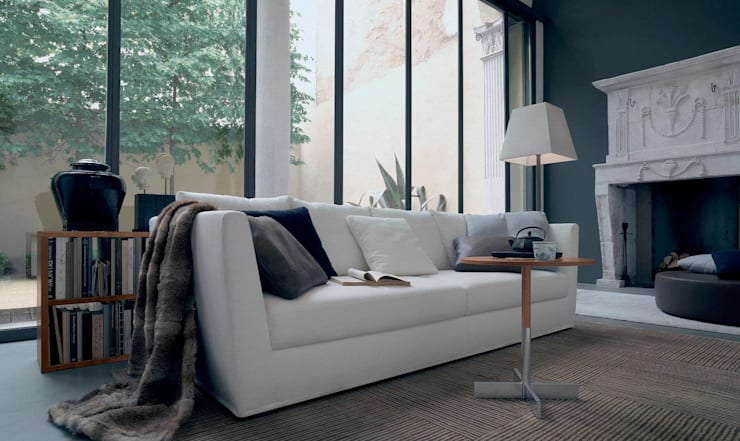 A Relaxing Lounge: modern  by Spacio Collections,Modern Textile Amber/Gold