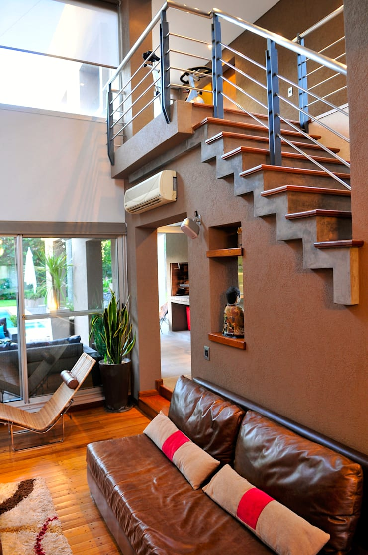 Casa <q>Integración al verde</q>: Livings de estilo  por Estudio Gore,Moderno