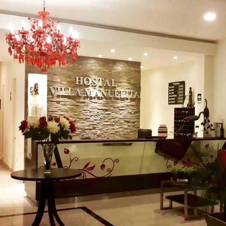 Recepción Hostal Villa Manuelita: Hoteles de estilo  por EPG  Studio