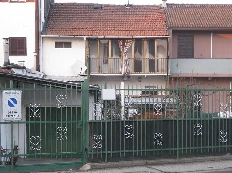 Casa a Novara:  in stile  di Studio di Architettura Ortu Pillola e Associati