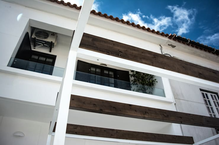 Terrace house by Grupo Norma