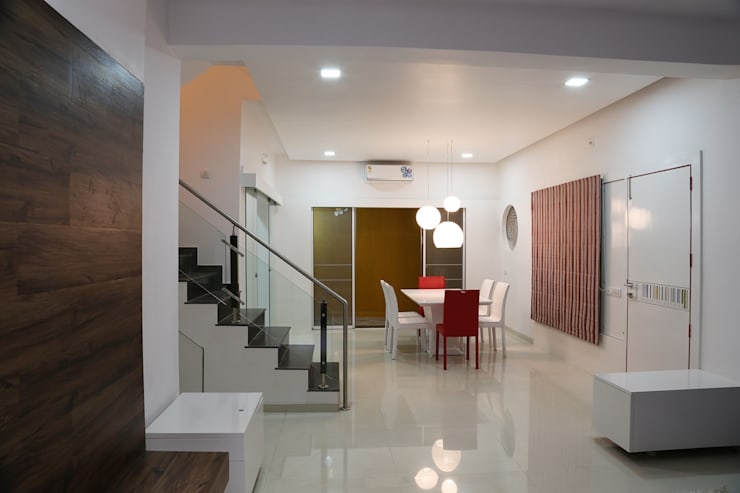 Single Family Private Residence, Ahmedabad:  Dining room by A New Dimension