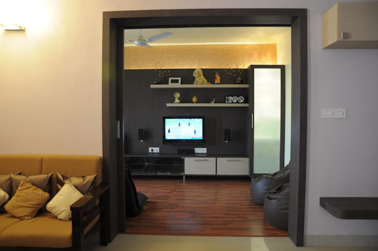 2 BHK APARTMENT INTERIORS IN BANGALORE:  Media room by BENCHMARK DESIGNS,Modern Plywood