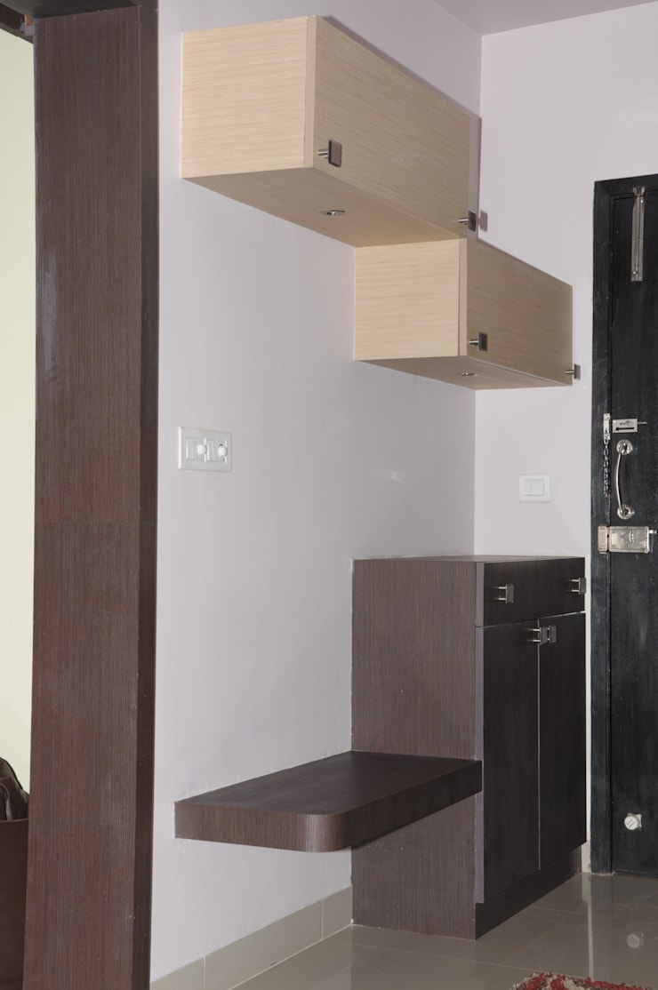 2 BHK APARTMENT INTERIORS IN BANGALORE:  Corridor & hallway by BENCHMARK DESIGNS,Modern Plywood