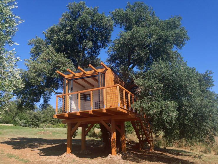 Chalés e casas de madeira  por Livingreen - Architetto Barbara Tavoso