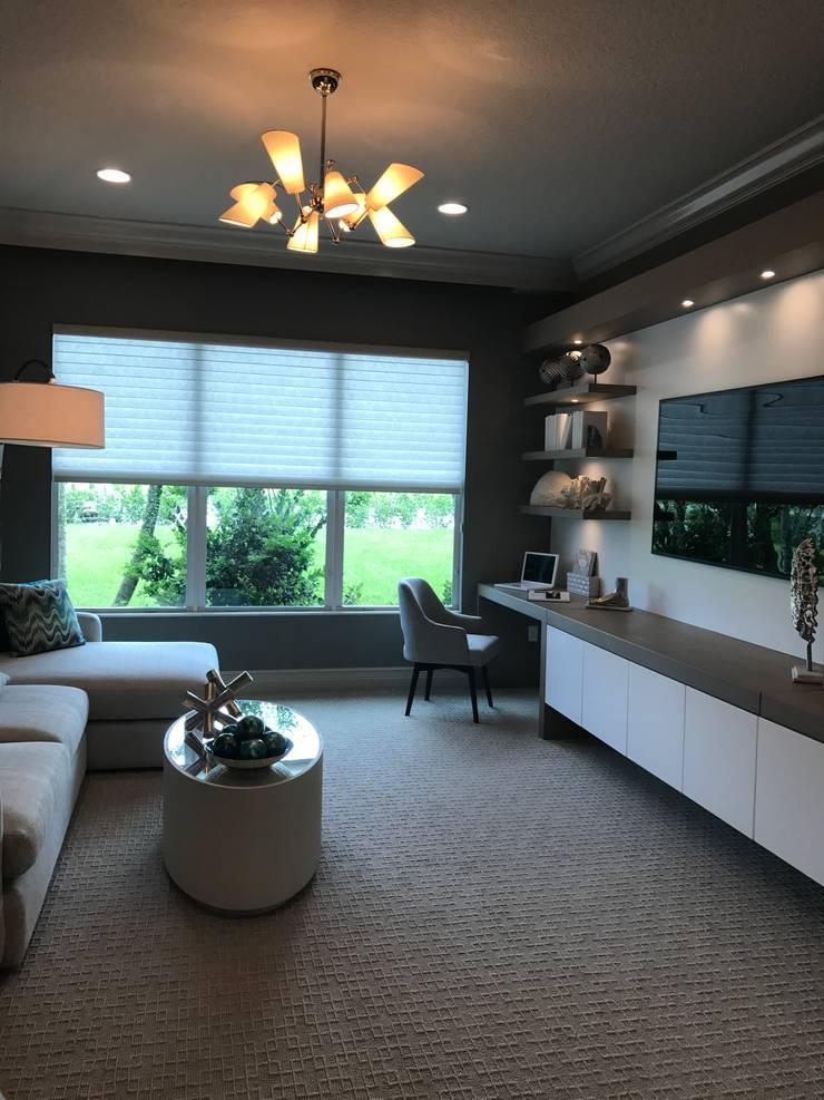 Oficina: Estudios y despachos de estilo moderno por Claudia Luján