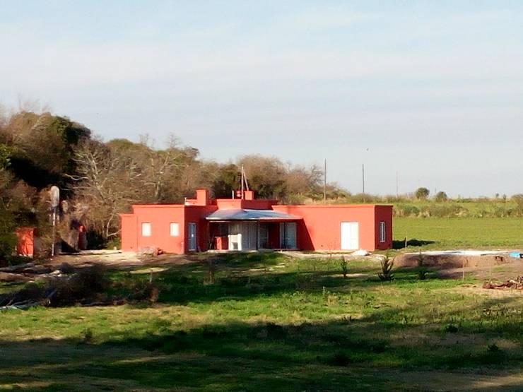 Campo&Golf: Casas de estilo  por Marcelo Manzán Arquitecto,