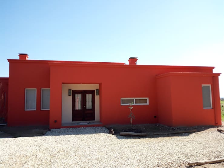 Campo&Golf: Casas unifamiliares de estilo  por Marcelo Manzán Arquitecto,