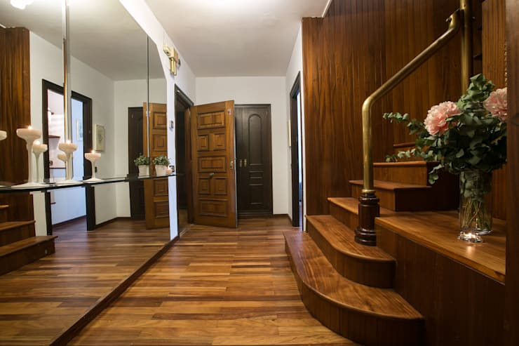 Pasillos y vestíbulos de estilo  por Redecoram Home Staging
