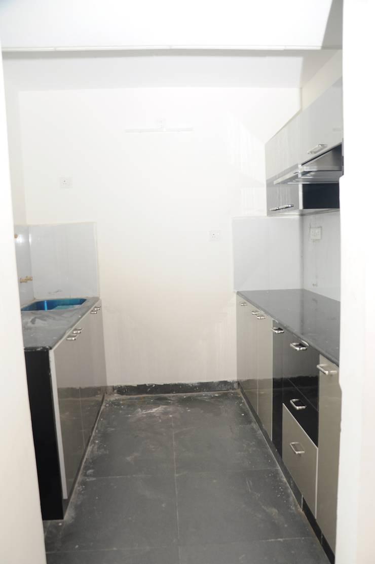 Residential Interior:  Kitchen by Azhagu Interior