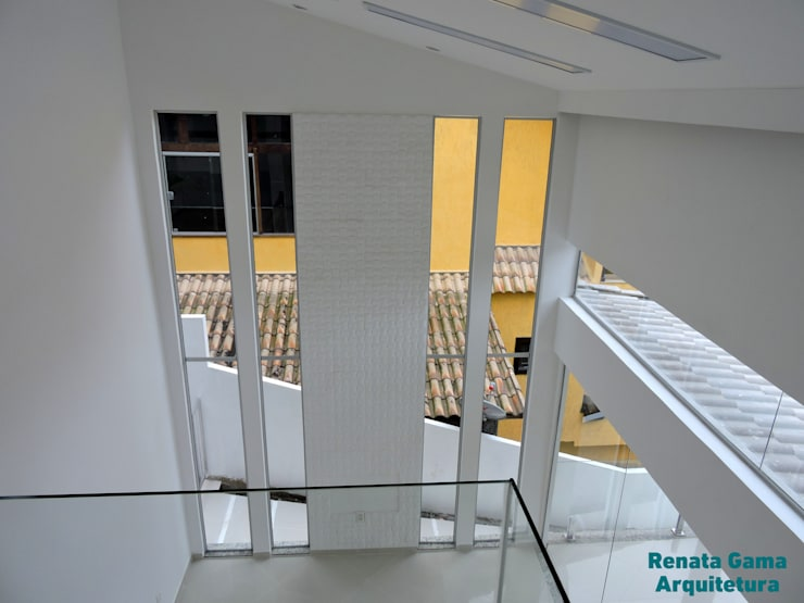 Living room by Renata Gama Arquitetura, Modern Bricks