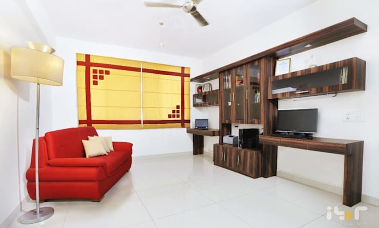 Family area -home office:  Office spaces & stores  by Interiors by ranjani