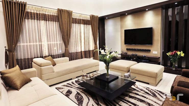 Living room -tv unit:  Living room by Interiors by ranjani