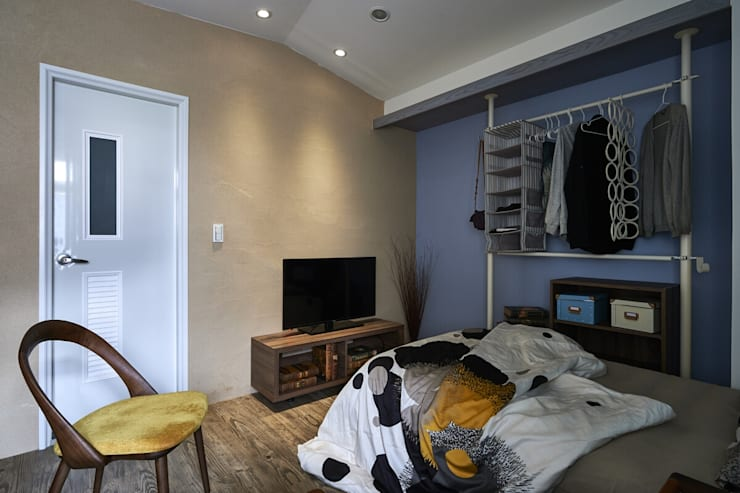 彩礫岩牆面:  臥室 by 第宅空間設計