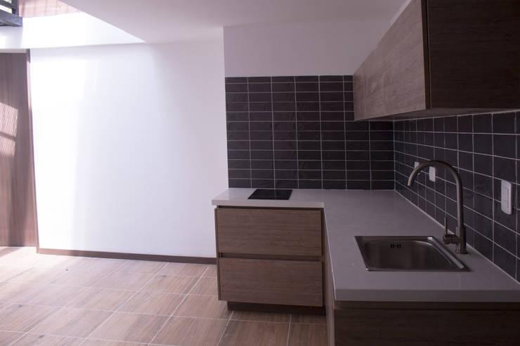 Apartamento 1: Cocinas de estilo  por santiago dussan architecture & Interior design, Ecléctico