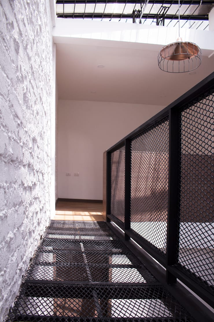 Apartamento 1: Habitaciones de estilo  por santiago dussan architecture & Interior design, Industrial Hierro/Acero