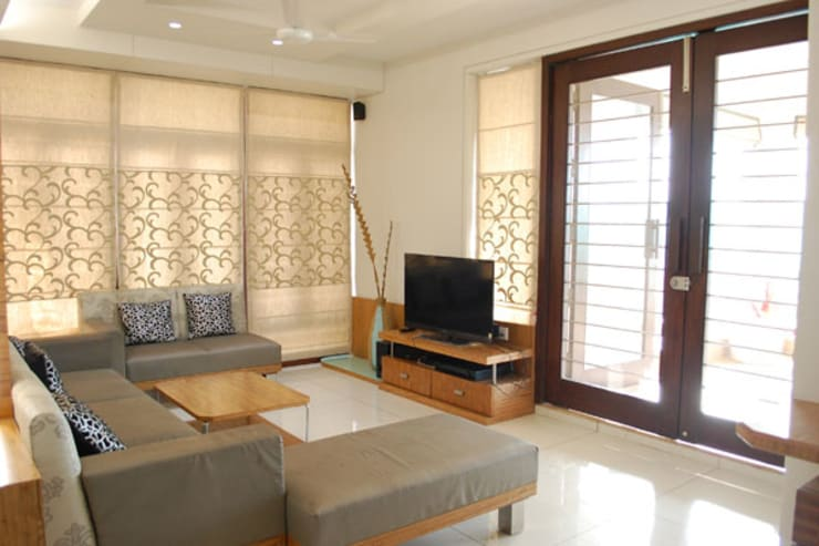 Residential:  Living room by Sumer Interiors