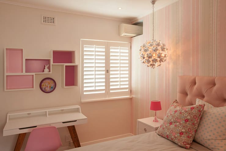 Quarto infantil  por Redesign Interiors