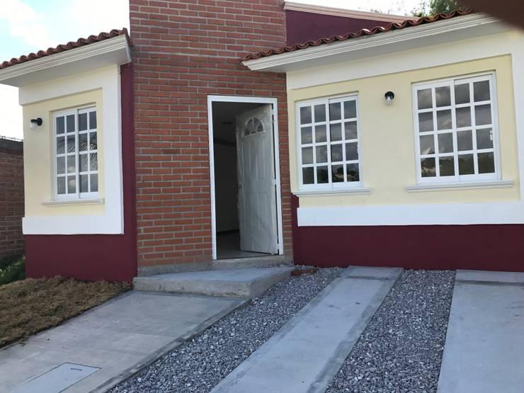 casa-terracota : Casas de estilo  por LUBAAL construcción y arquitectura
