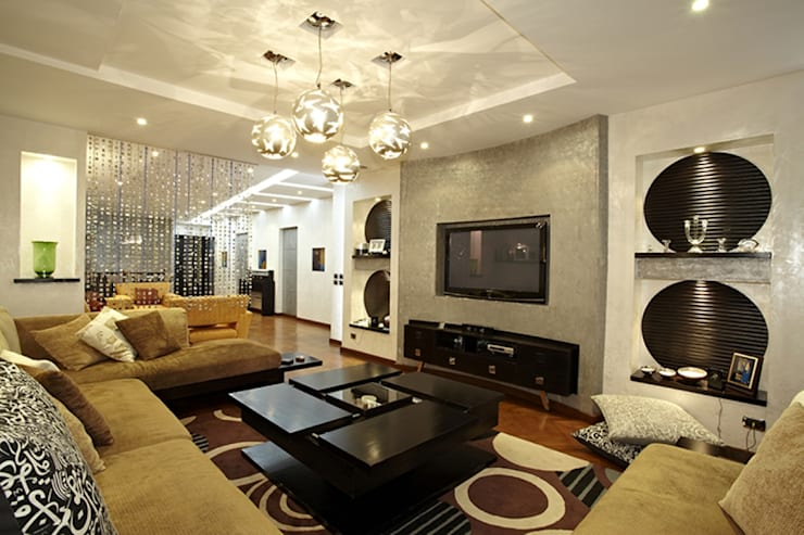 Dokki Apartment:  غرفة الميديا تنفيذ Hazem Hassan Designs