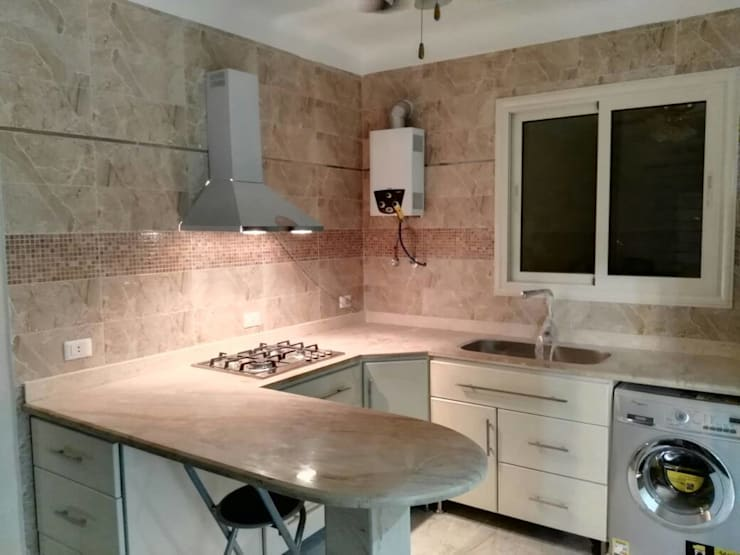 اضاءة مطبخ:  وحدات مطبخ تنفيذ New Home Architecture