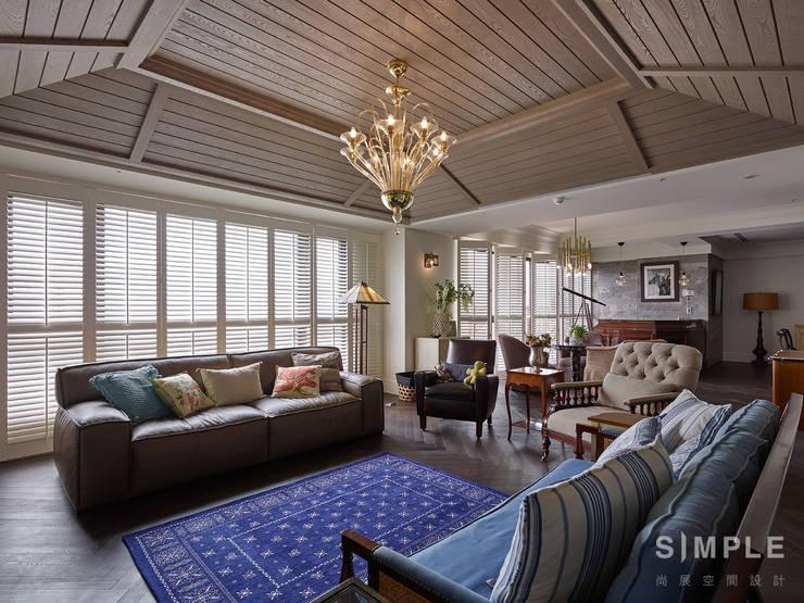 Living room by 尚展空間設計