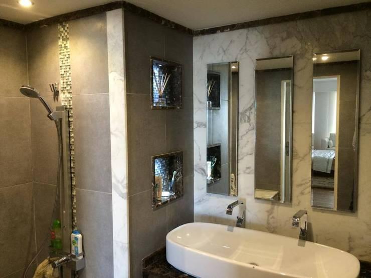 حمام غرفة النوم الماستر :  حمام تنفيذ Quattro designs