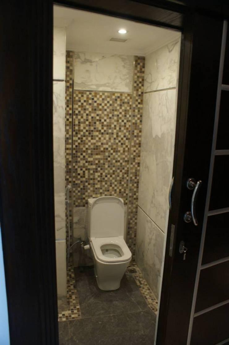 حمام الضيوف :  حمام تنفيذ Quattro designs ,