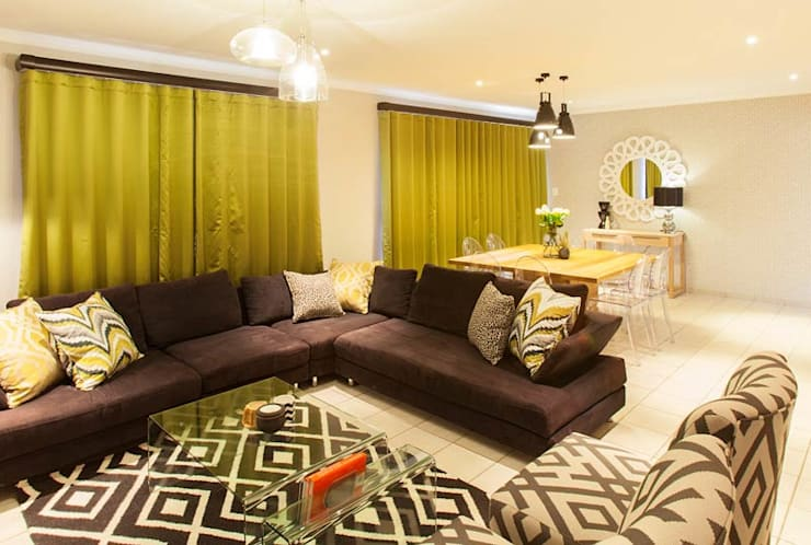 House Nair :  Living room by Redesign Interiors