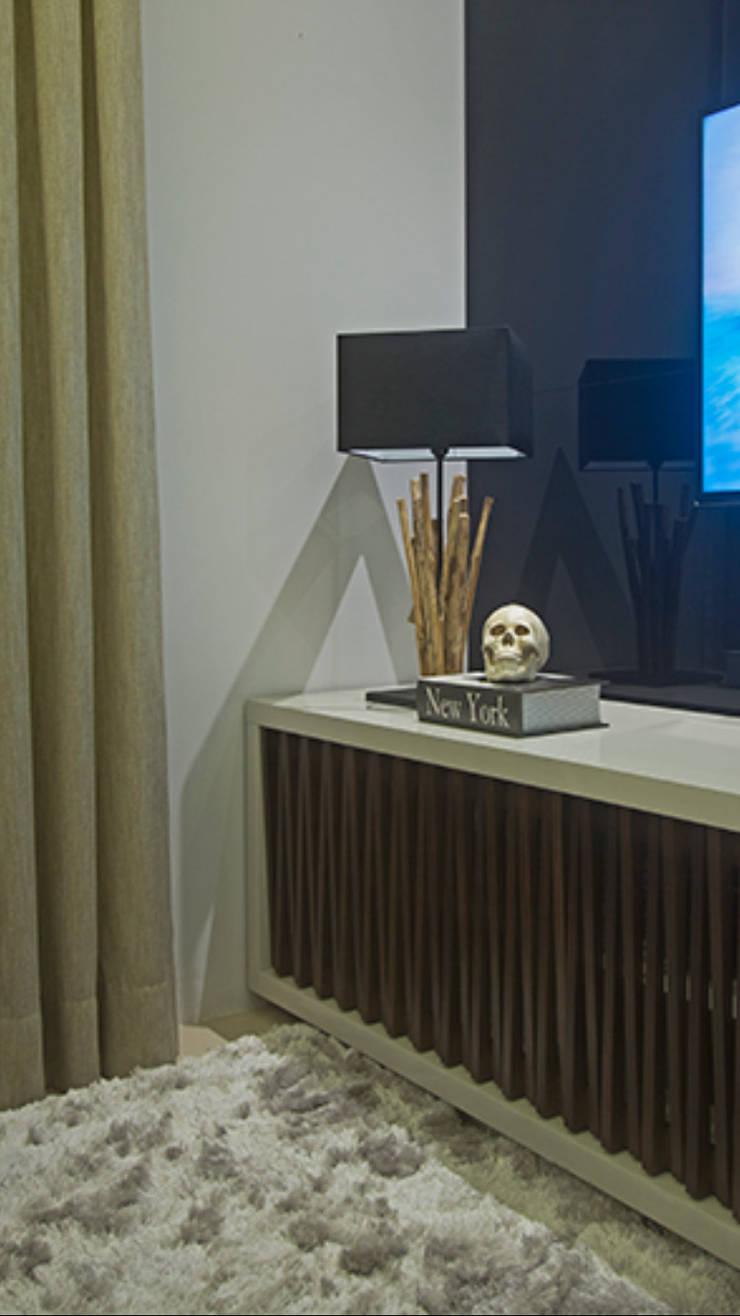 Apartamento Brooklin: Salas de estar  por Nuovo Design de Interiores,