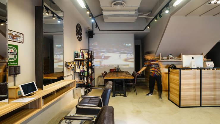 餐飲區域:  商業空間 by 見和空間設計
