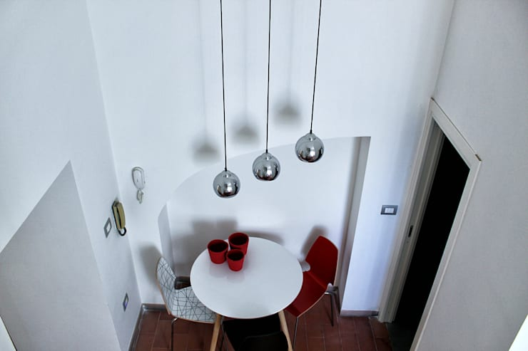 Open Space: Sala da pranzo in stile  di redesign lab