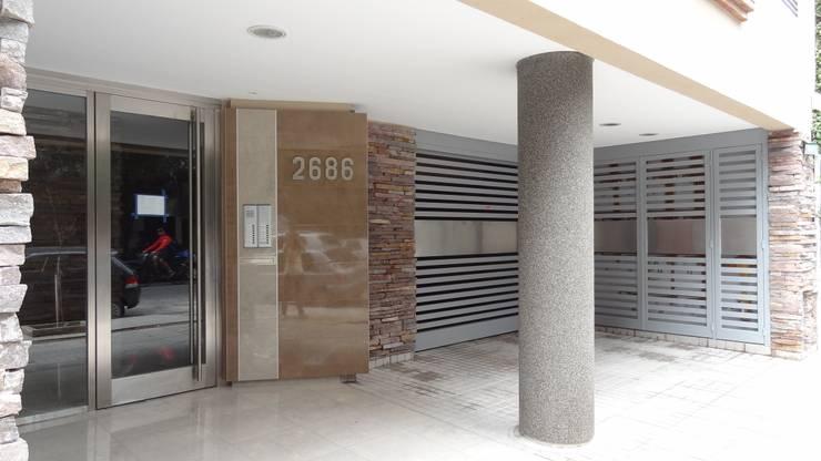 Edificio de viviendas Ugarte:  de estilo  por Grupo CN,