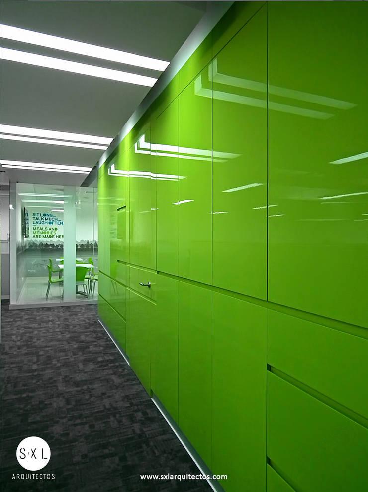Oficinas Pacific Rubiales Energy: Oficinas de estilo  por SXL ARQUITECTOS