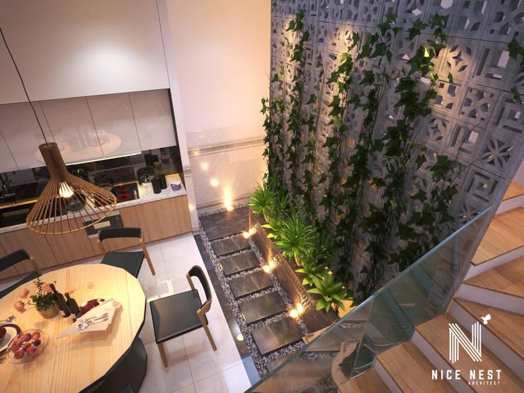 Nhà 2 tầng của gia đình giao viên tại Cần Thơ:   by Công Ty TNHH tư vấn thiết kế kiến trúc NiceNest